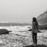 SECOND PLACE 10.0 Beautifully done image with the girl standing on the rock watching the waves. Looks like a foggy day. Depth of field, composition, and exposure all look good to me and the girl and waves hold my interest.